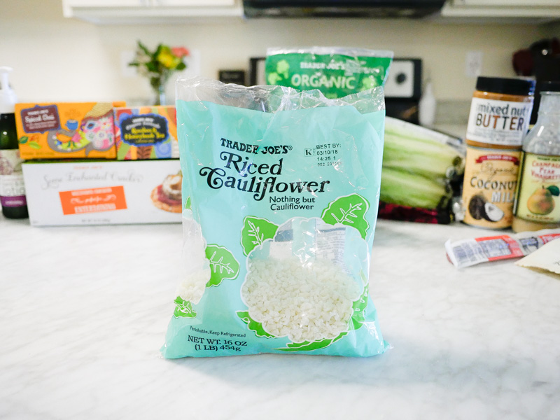 Trader Joes Riced Cauliflower On A Marble Countertop for Jessica Wallas YouTube Video About Favorites Keto and Whole30
