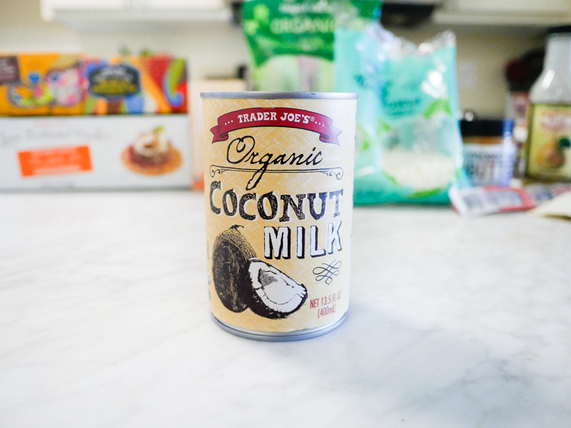 Trader Joes Organic Coconut Milk On A Marble Countertop for Jessica Wallas YouTube Video About Favorites Keto and Whole30