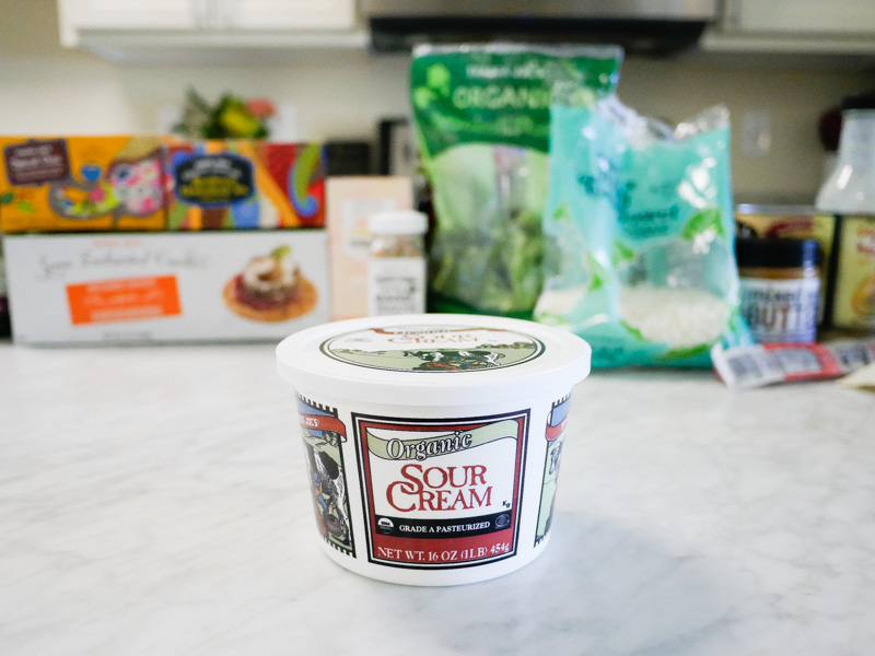 Trader Joes Sour Cream on a marble counter top for jessica wallas favorites video for keto and whole30