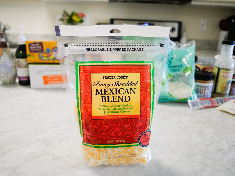 Trader Joes Mexican Blend Cheese on a marble countertop for jessica wallas favorites video for keto and whole30