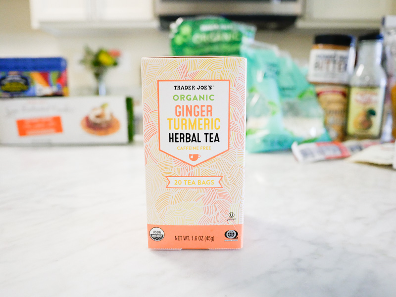 Trader Joes Organic Ginger Tumeric Herbal Tea On A Marble Countertop for Jessica Wallas YouTube Video About Favorites Keto and Whole30
